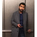 THE LOVEBIRDS KUMAIL NANJIANI GREY COAT